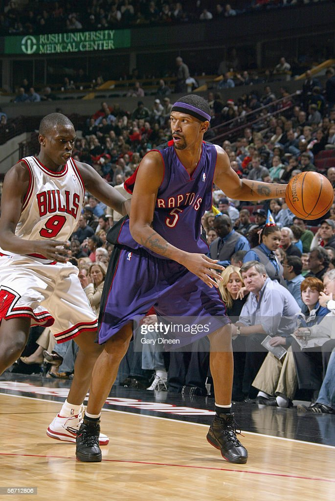 Jalen Rose #5 of the Toronto Raptors dribbles against Luol Deng #9 of the Chicago Bulls during the game at the United Center on January 9, 2006 in Chicago, Illinois. The Bulls won 113-104.