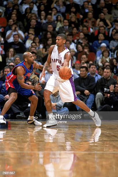 Jalen Rose of the Toronto Raptors looks to hand off the ball while defended by Chucky Atkins of the Detroit Pistons during the game at Air Canada...