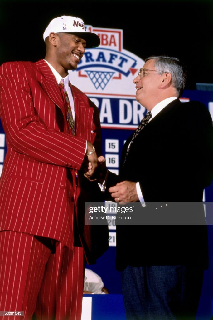 Jalen Rose, poses with NBA Commissioner, David Stern after being drafted by the Denver Nuggets in the first round of the 1994 NBA Draft.
