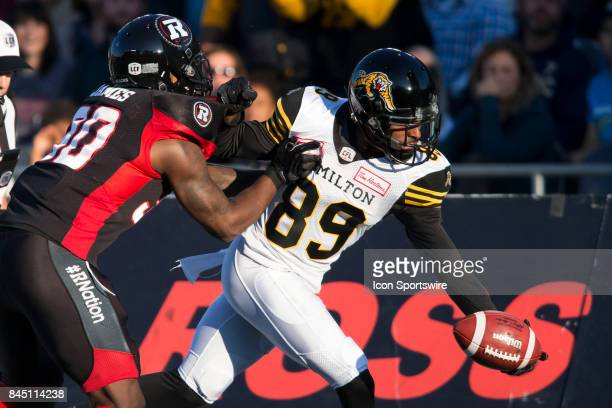 Jalen Saunders of the Hamilton TigerCats reaches to set up a first down very early in the first half against the Ottawa Redblacks in Canadian...