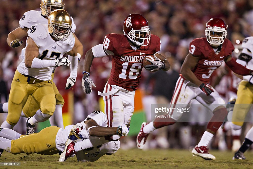 Jalen Saunders #18 of the Oklahoma Sooners is tackled after catching a pass against the Notre Dame Fighting Irish at Gaylord Family Oklahoma Memorial Stadium on October 27, 2012 in Norman, Oklahoma. The Fighting Irish defeated the Sooners 30-13.