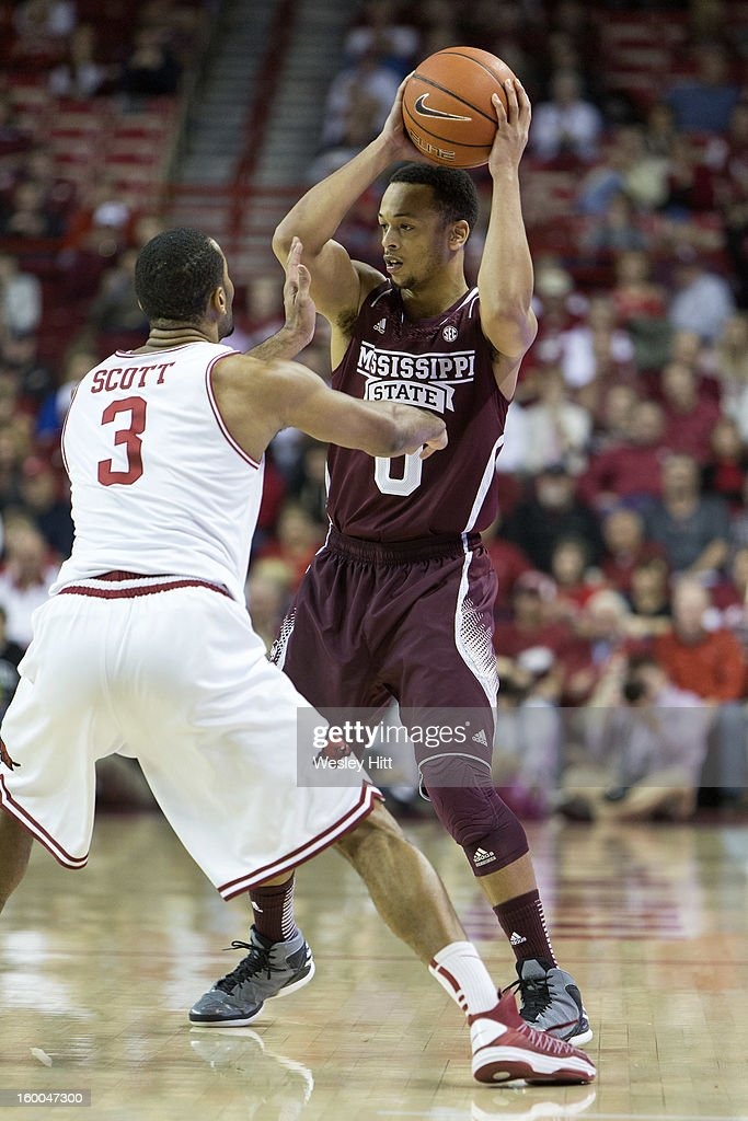 Jalen Steele #0 of the Mississippi State Bulldogs looks to pass the ball under pressure from Rickey Scott #3 of the Arkansas Razorbacks at Bud Walton Arena on January 23, 2013 in Fayetteville, Arkansas. The Razorbacks defeated the Bulldogs 96-70.
