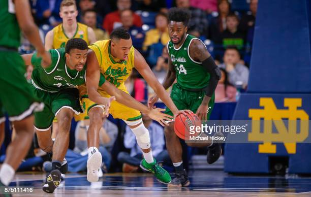 Jalen StephensHolmes of the Chicago State Cougars and Bonzie Colson of the Notre Dame Fighting Irish reach for the loose ball at Purcell Pavilion on...