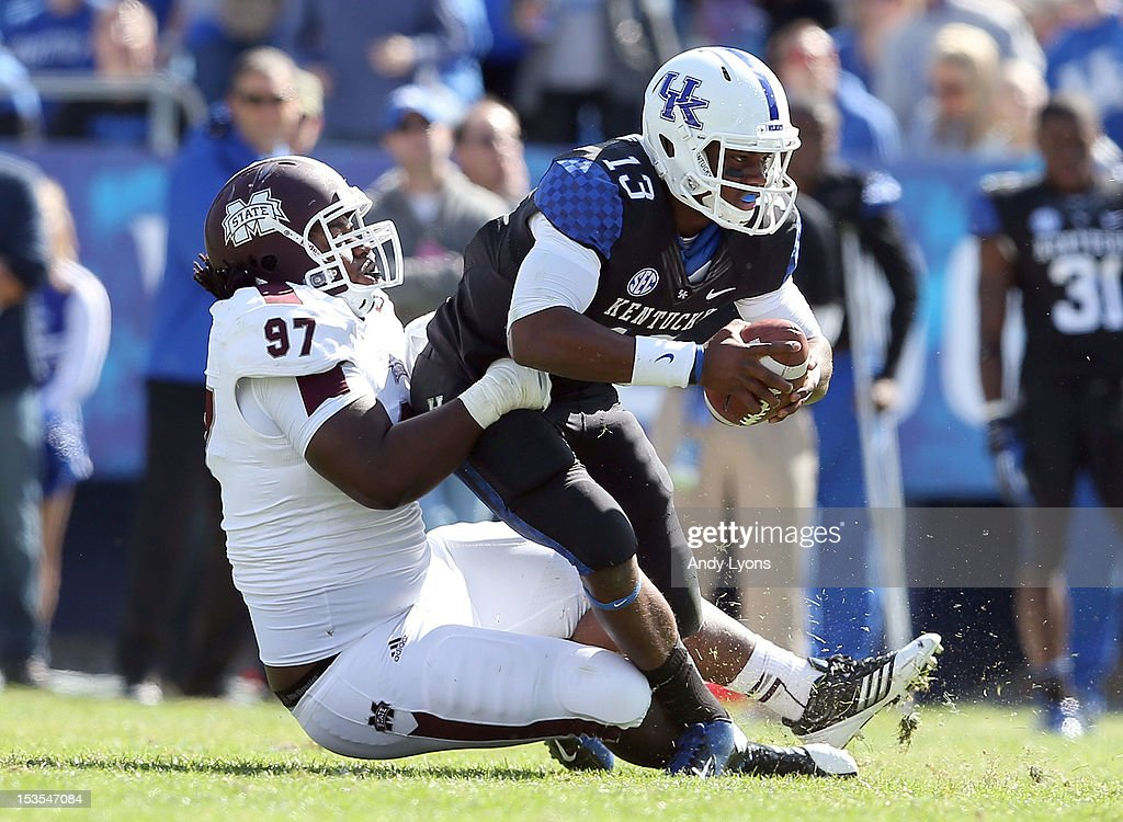 Jalen Whitlow #13 of the Kentucky Wildcats is sacked by Josh Boyd #97 of the Mississippi State Bulldogs during the SEC game at Commonwealth Stadium on October 6, 2012 in Lexington, Kentucky.