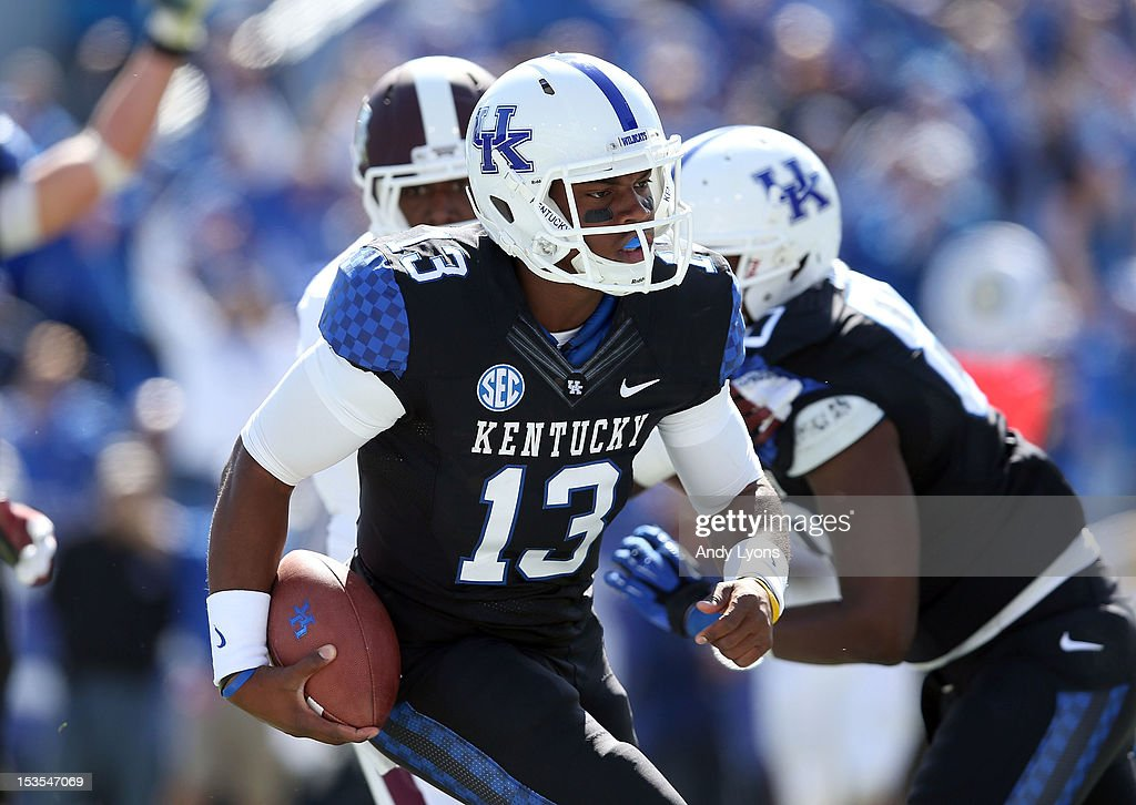 Jalen Whitlow #13 of the Kentucky Wildcats runs for a touchdown during the SEC game against the Mississippi State Bulldogs at Commonwealth Stadium on October 6, 2012 in Lexington, Kentucky.