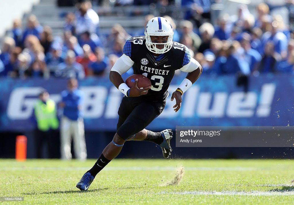 Jalen Whitlow #13 of the Kentucky Wildcats runs with the ball during the SEC game against the Mississippi State Bulldogs at Commonwealth Stadium on October 6, 2012 in Lexington, Kentucky.