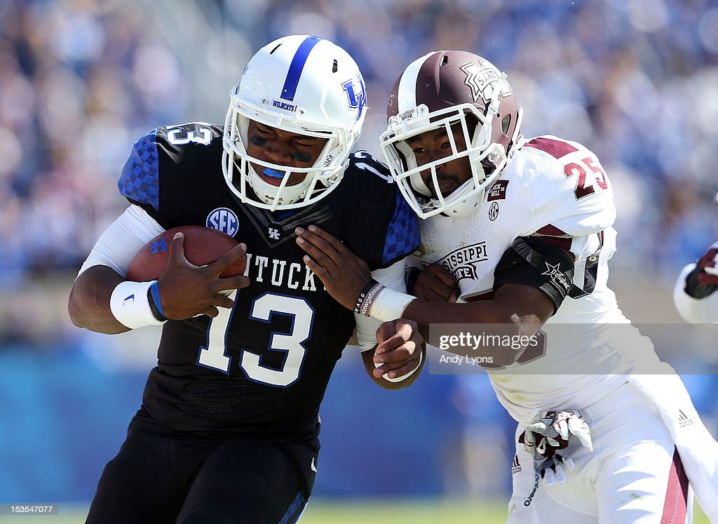 Jalen Whitlow #13 of the Kentucky Wildcats runs with the ball while defended by Corey Broomfield #25 of the Mississippi State Bulldogs during the SEC game at Commonwealth Stadium on October 6, 2012 in Lexington, Kentucky.