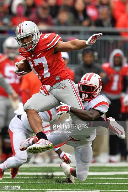 Jalin Marshall of the Ohio State Buckeyes attempts to elude the tackle of Gareef Glashen of the Rutgers Scarlet Knights in the second quarter on...