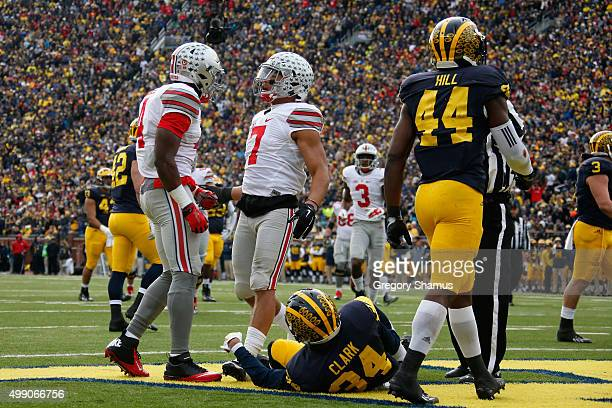 Jalin Marshall of the Ohio State Buckeyes celebrates with teammate Curtis Samuel after catching a third quarter touchdown pass against the Michigan...