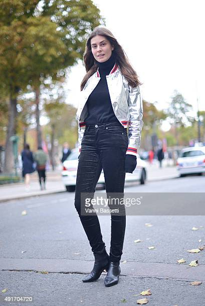 Jalouse magazine's Helena Tejedor poses after the Moncler Gamme Rouge show at the Grand Palais during Paris Fashion Week SS16 on October 7 2015 in...