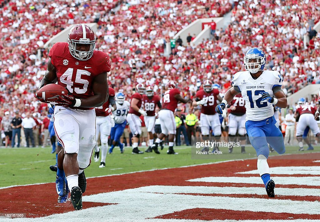 Jalston Fowler #45 of the Alabama Crimson Tide pulls in this touchdown reception against the Georgia State Panthers at Bryant-Denny Stadium on October 5, 2013 in Tuscaloosa, Alabama.