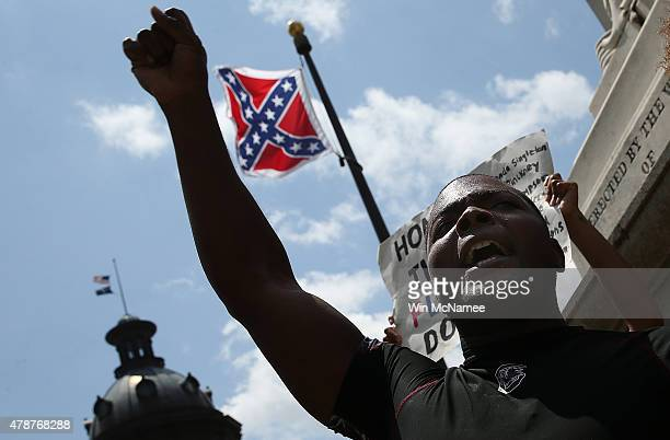 Jaluladin AbdulHamib shouts 'Take It Down' while engaging with a group of demonstrators on the grounds of the South Carolina State House calling for...