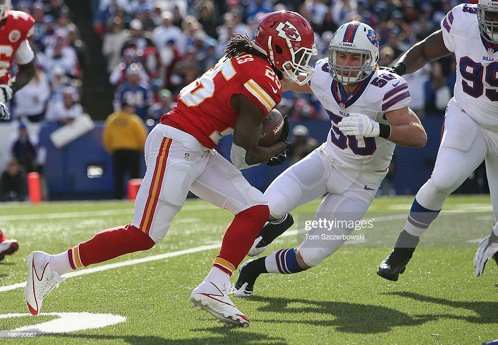 <a gi-track='captionPersonalityLinkClicked' href=/galleries/search?phrase=Jamaal+Charles&family=editorial&specificpeople=2122501 ng-click='$event.stopPropagation()'>Jamaal Charles</a> #25 of the Kansas City Chiefs carries the ball during NFL game action as <a gi-track='captionPersonalityLinkClicked' href=/galleries/search?phrase=Kiko+Alonso&family=editorial&specificpeople=6560972 ng-click='$event.stopPropagation()'>Kiko Alonso</a> #50 of the Buffalo Bills bears down on him at Ralph Wilson Stadium on November 3, 2013 in Orchard Park, New York.