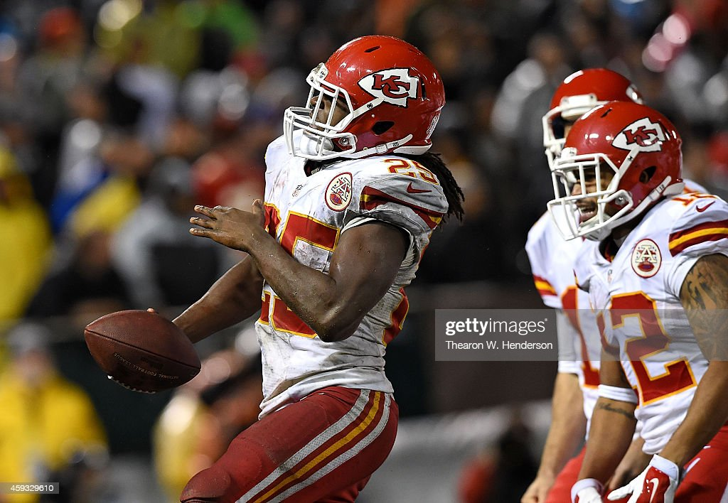 <a gi-track='captionPersonalityLinkClicked' href=/galleries/search?phrase=Jamaal+Charles&family=editorial&specificpeople=2122501 ng-click='$event.stopPropagation()'>Jamaal Charles</a> #25 of the Kansas City Chiefs celebrates with <a gi-track='captionPersonalityLinkClicked' href=/galleries/search?phrase=Albert+Wilson+-+American+Football+Player&family=editorial&specificpeople=13547965 ng-click='$event.stopPropagation()'>Albert Wilson</a> #12 after scoring a touchdown during the game against the Oakland Raiders at O.co Coliseum on November 20, 2014 in Oakland, California.