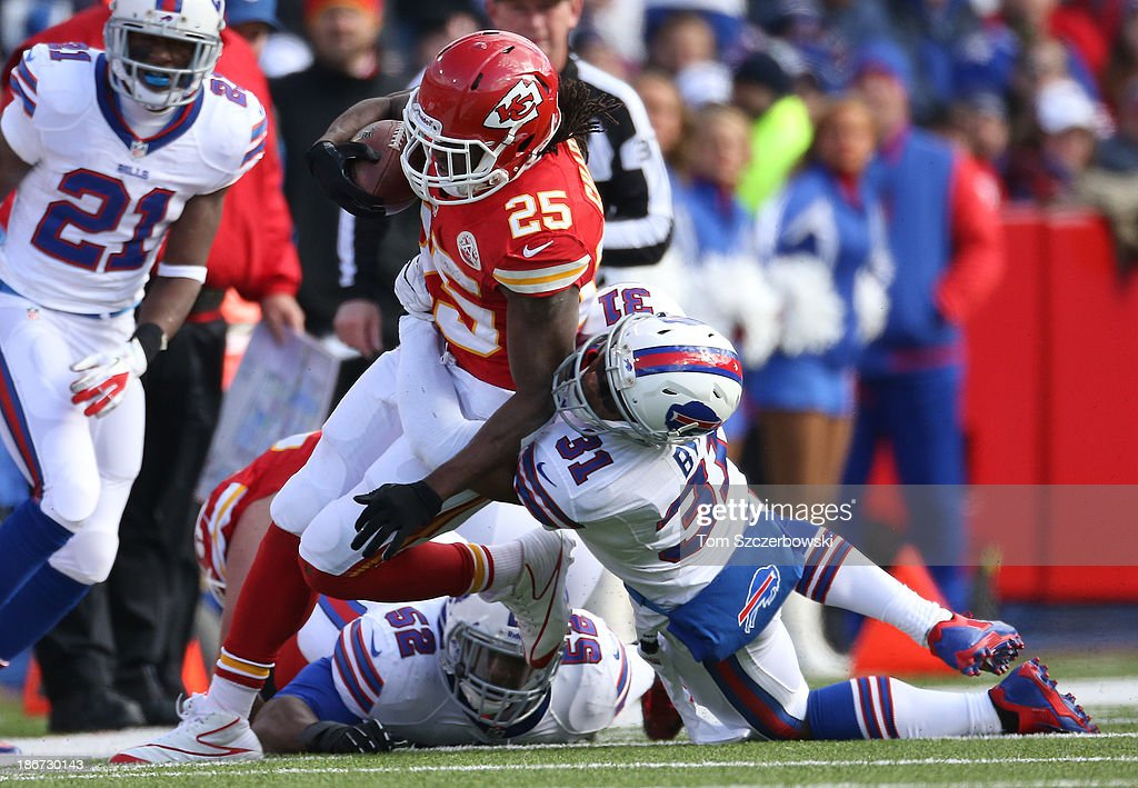 <a gi-track='captionPersonalityLinkClicked' href=/galleries/search?phrase=Jamaal+Charles&family=editorial&specificpeople=2122501 ng-click='$event.stopPropagation()'>Jamaal Charles</a> #25 of the Kansas City Chiefs is tackled as he carries the ball during NFL game action by <a gi-track='captionPersonalityLinkClicked' href=/galleries/search?phrase=Jairus+Byrd&family=editorial&specificpeople=4516279 ng-click='$event.stopPropagation()'>Jairus Byrd</a> #31 of the Buffalo Bills at Ralph Wilson Stadium on November 3, 2013 in Orchard Park, New York.