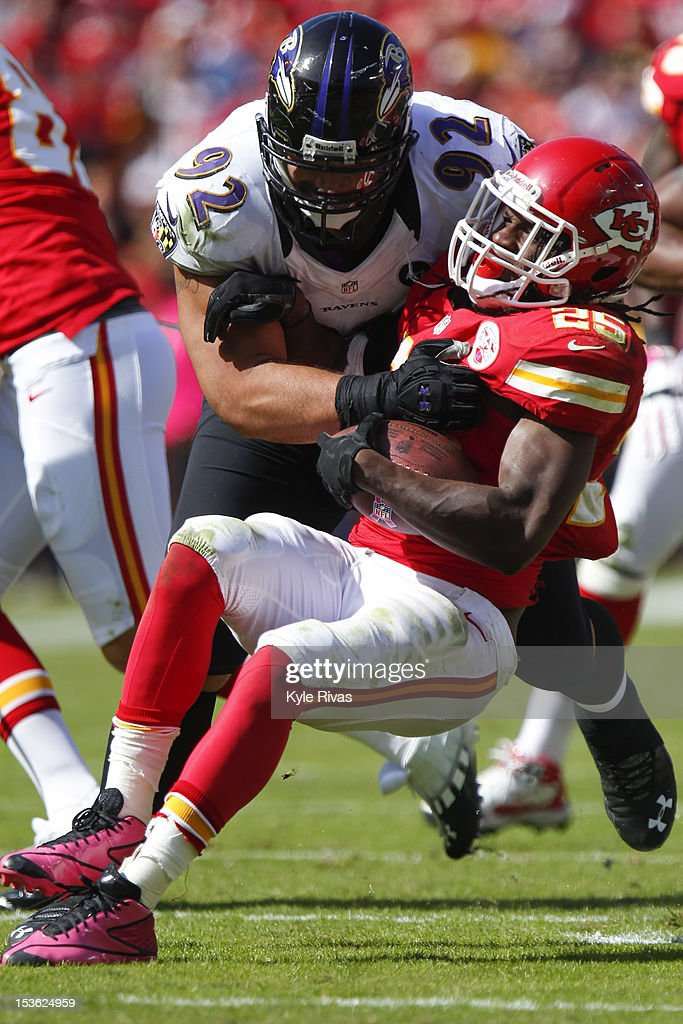 Jamaal Charles #25 of the Kansas City Chiefs is thrown down to the ground by Haloti Ngata #92 of the Baltimore Ravens near the forty early in the third quarter on October 07, 2012 at Arrowhead Stadium in Kansas City, Missouri.
