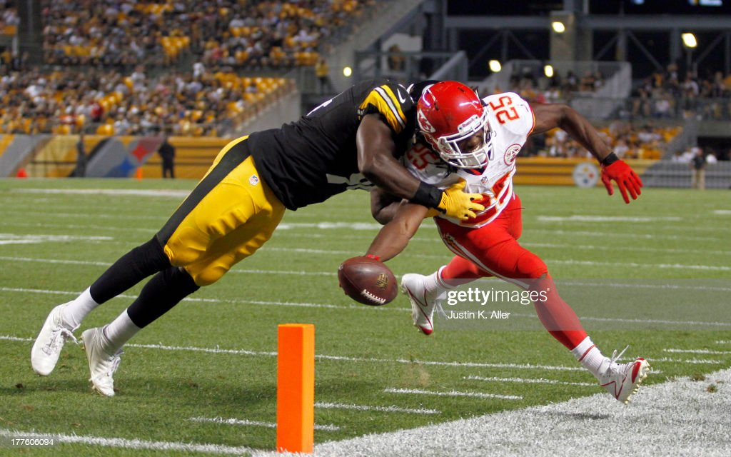 Jamaal Charles #25 of the Kansas City Chiefs reaches for the pylon against Lawrence Timmons #94 of the Pittsburgh Steelers in the first half during the game on August 24, 2013 at Heinz Field in Pittsburgh, Pennsylvania.