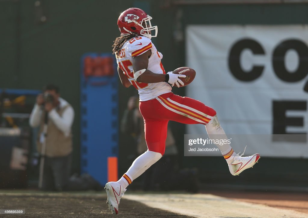 <a gi-track='captionPersonalityLinkClicked' href=/galleries/search?phrase=Jamaal+Charles&family=editorial&specificpeople=2122501 ng-click='$event.stopPropagation()'>Jamaal Charles</a> #25 of the Kansas City Chiefs runs for a touchdown against the Oakland Raiders at O.co Coliseum on December 15, 2013 in Oakland, California.
