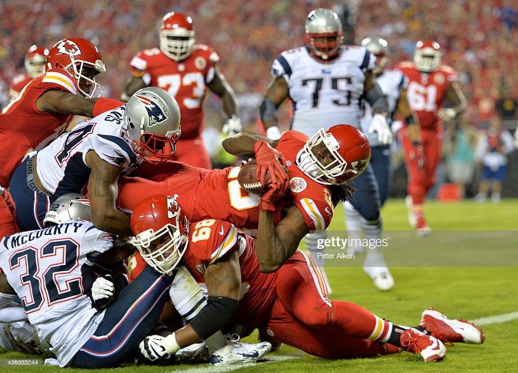 <a gi-track='captionPersonalityLinkClicked' href=/galleries/search?phrase=Jamaal+Charles&family=editorial&specificpeople=2122501 ng-click='$event.stopPropagation()'>Jamaal Charles</a> #25 of the Kansas City Chiefs scores a touchdown against the New England Patriots during the second quarter at Arrowhead Stadium on September 29, 2014 in Kansas City, Missouri.