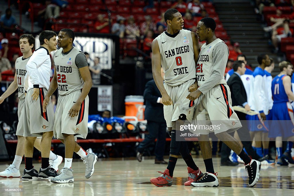Jamaal Franklin #21 of the San Diego State Aztecs celebrates with team-mate Skylar Spencer #0 after defeating the Boise State Broncos during a quarterfinal game of the Reese's Mountain West Conference Basketball tournament at the Thomas & Mack Center on March 13, 2013 in Las Vegas, Nevada. SDSU won 73-67.