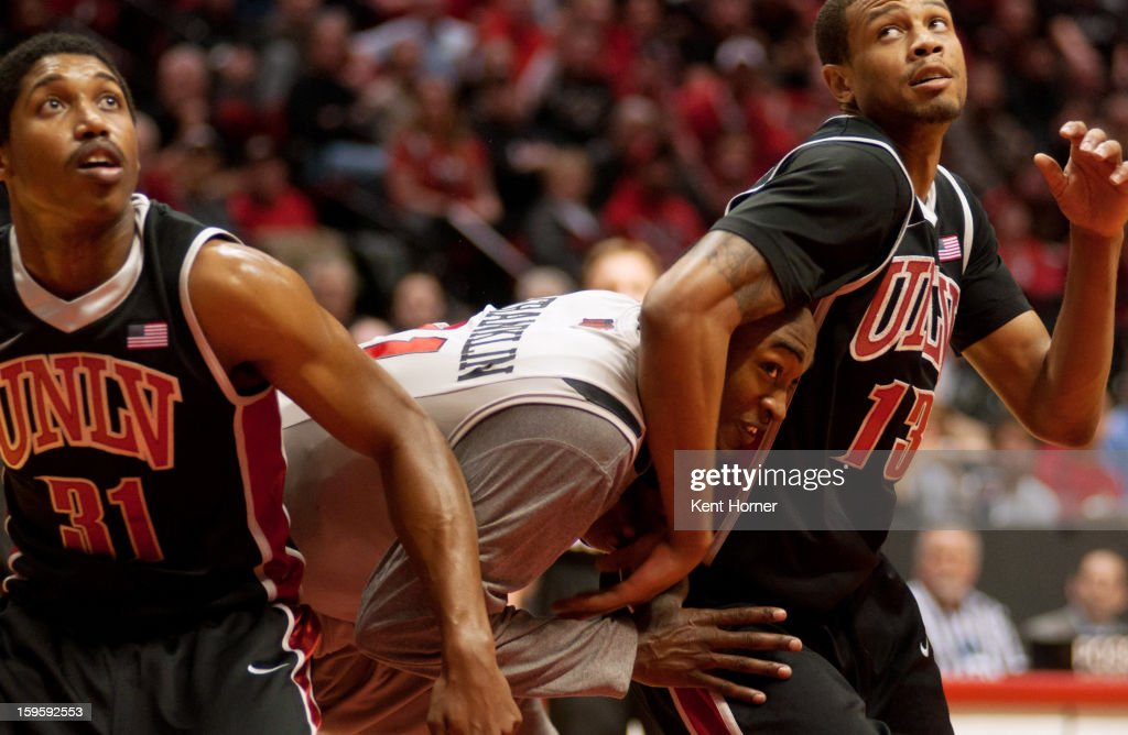 Jamaal Franklin #21 of the San Diego State Aztecs fights for position during a free throw in the second half of the game against <a gi-track='captionPersonalityLinkClicked' href=/galleries/search?phrase=Bryce+Dejean-Jones&family=editorial&specificpeople=10097417 ng-click='$event.stopPropagation()'>Bryce Dejean-Jones</a> #13 of the UNLV Runnin' Rebels at Viejas Arena on January 16, 2013 in San Diego, California.