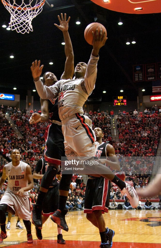 Jamaal Franklin #21 of the San Diego State Aztecs shoots the ball from under the basket in the first half of the game against the UNLV Runnin' Rebels at Viejas Arena on January 16, 2013 in San Diego, California.