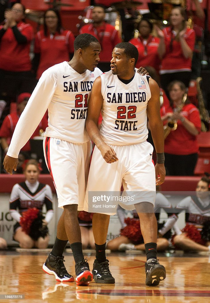 Jamaal Franklin #21 of the San Diego State Aztecs talks with teammate Chase Tapley #22 after a hard foul called late in the second half of the game against the Colorado State Rams at Viejas Arena on January 12, 2013 in San Diego, California.