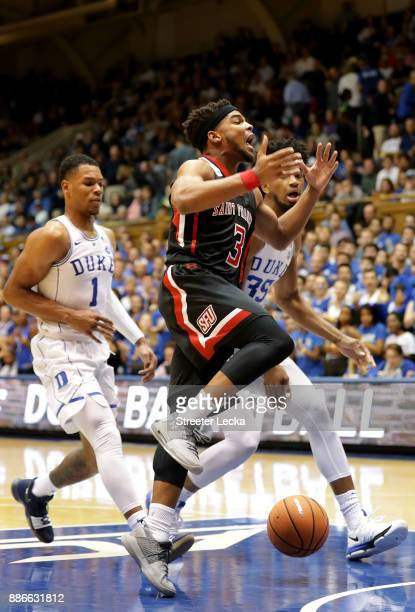 Jamaal King of the St Francis Red Flash has the ball knocked loose by teammates Trevon Duval and Marvin Bagley III of the Duke Blue Devils during...