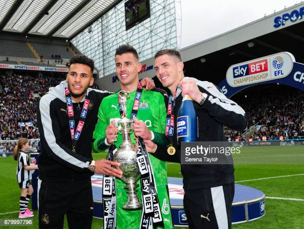 Jamaal Lascelles Goalkeeper Karl Darlow and Ciaran Clark pose for a photo with the championship trophy after Newcastle win the championship during...