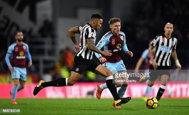Jamaal Lascelles of Newcastle United and Adam Legzdins of Burnley in action during the Premier League match between Burnley and Newcastle United at...