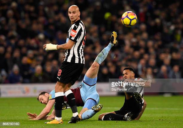 Jamaal Lascelles of Newcastle United and Ashley Barnes of Burnley reacts during the Premier League match between Burnley and Newcastle United at Turf...