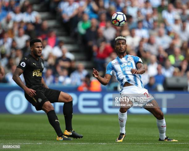 Jamaal Lascelles of Newcastle United and Steve Mounie of Huddersfield Town during the Premier League match between Huddersfield Town and Newcastle...