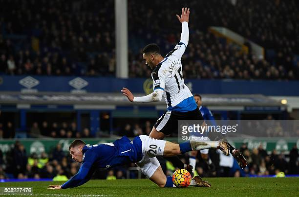 Jamaal Lascelles of Newcastle United brings down Ross Barkley of Everton to concede a penalty during the Barclays Premier League match between...