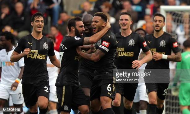 Jamaal Lascelles of Newcastle United celebrates his goal with team mates during the Premier League match between Swansea City and Newcastle United at...