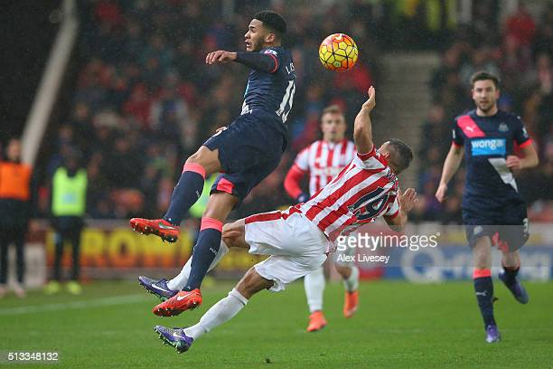Jamaal Lascelles of Newcastle United jumps for the ball with Jonathan Walters of Stoke City during the Barclays Premier League match between Stoke...