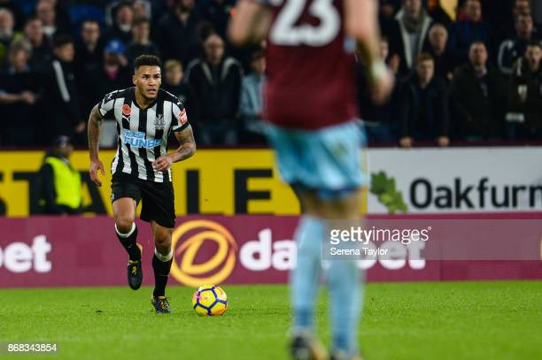 Jamaal Lascelles of Newcastle United runs with the ball during the Premier League match between Burnley and Newcastle United at Turf Moore on October...