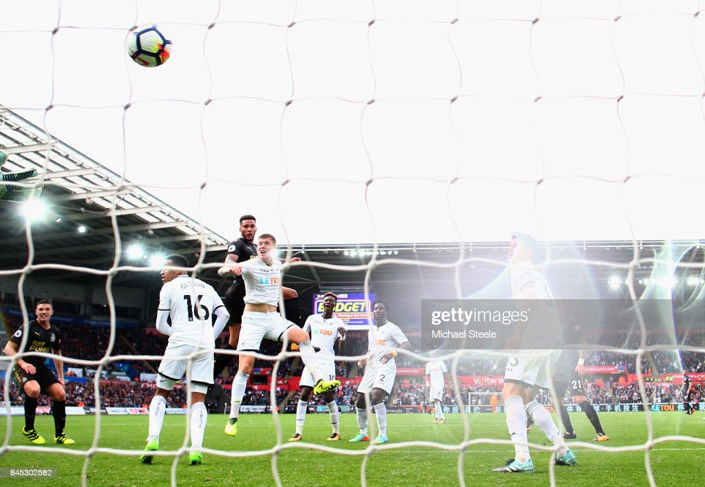 Jamaal Lascelles of Newcastle United scores his sides first goal during the Premier League match between Swansea City and Newcastle United at Liberty Stadium on September 10, 2017 in Swansea, Wales.