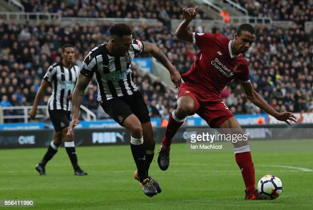Jamaal Lascelles of Newcastle United vies with Joel Matip of Liverpool during the Premier League match between Newcastle United and Liverpool at St...