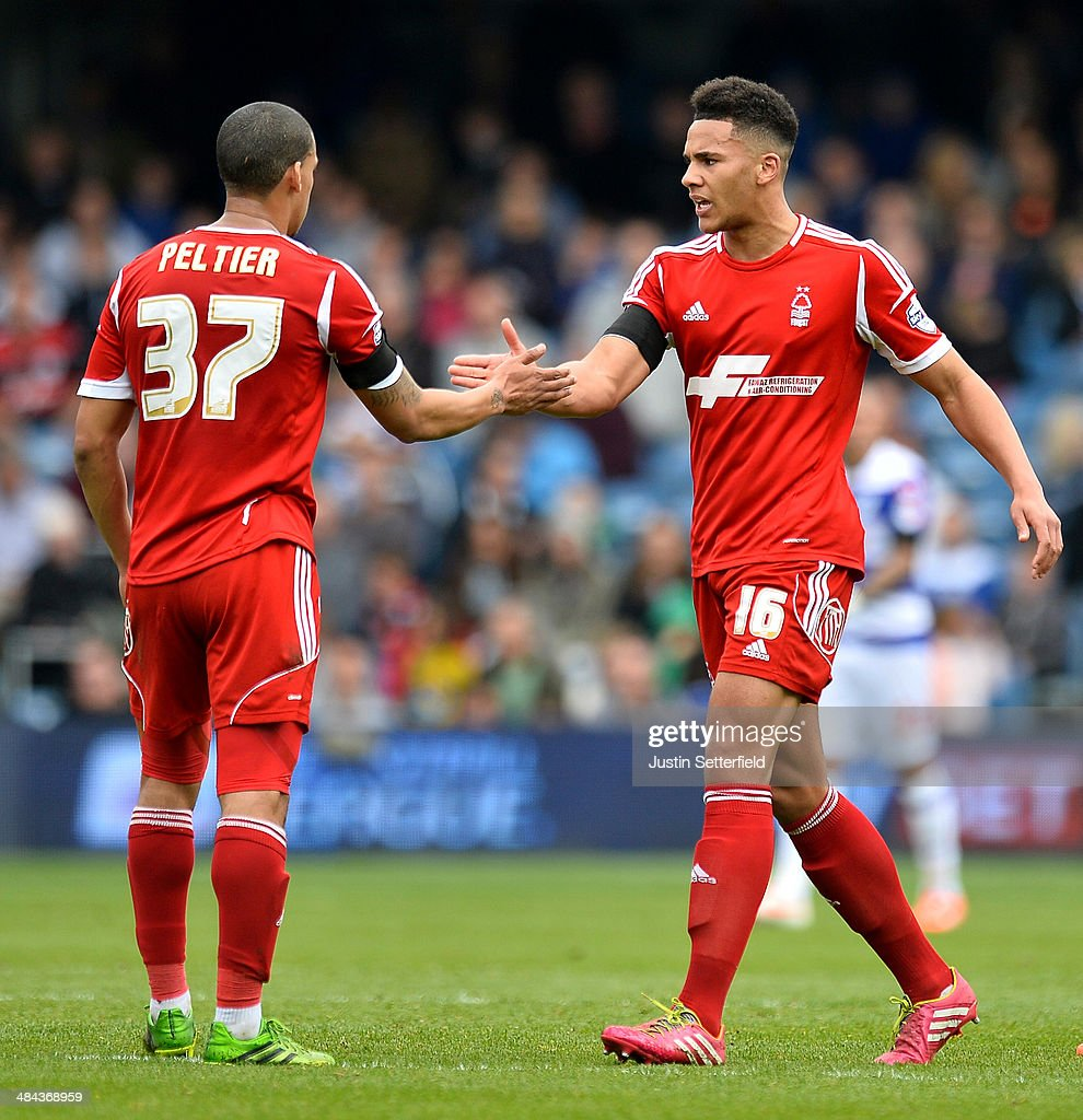 <a gi-track='captionPersonalityLinkClicked' href=/galleries/search?phrase=Jamaal+Lascelles&family=editorial&specificpeople=8953270 ng-click='$event.stopPropagation()'>Jamaal Lascelles</a> of Nottingham Forest celebrates scoring Nottingham Forest's 1st goal with <a gi-track='captionPersonalityLinkClicked' href=/galleries/search?phrase=Lee+Peltier&family=editorial&specificpeople=1007594 ng-click='$event.stopPropagation()'>Lee Peltier</a> of Nottingham Forest during the Sky Bet Championship match between Queens Park Rangers and Nottingham Forest at Loftus Road on April 12, 2014 in London, England.
