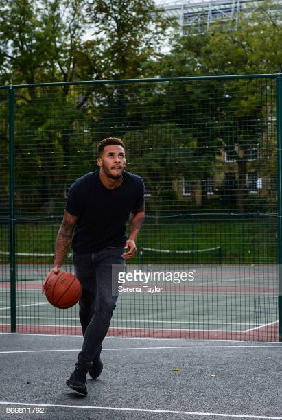Jamaal Lascelles poses for photos with a basketball during a photoshoot in Leazes Park on September 21 2017 in Newcastle England