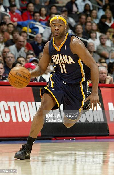 Jamaal Tinsley of the Indiana Pacers drives the ball across the court during the game against the Los Angeles Clippers at Staples Center on November...
