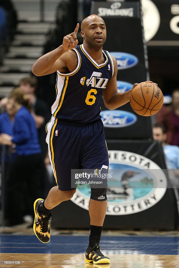 <a gi-track='captionPersonalityLinkClicked' href=/galleries/search?phrase=Jamaal+Tinsley&family=editorial&specificpeople=202203 ng-click='$event.stopPropagation()'>Jamaal Tinsley</a> #6 of the Utah Jazz brings the ball up court against the Minnesota Timberwolves on February 13, 2013 at Target Center in Minneapolis, Minnesota.