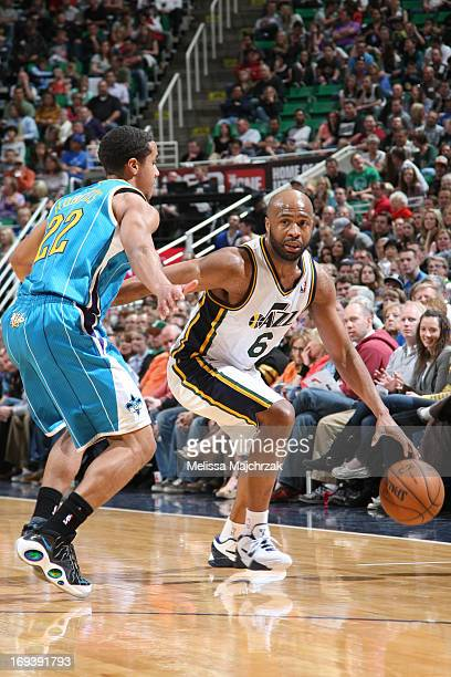 Jamaal Tinsley of the Utah Jazz drives against Brian Roberts of the New Orleans Hornets at Energy Solutions Arena on April 5 2013 in Salt Lake City...