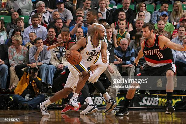 Jamaal Tinsley of the Utah Jazz drives against Joel Freeland of the Portland Trail Blazers at Energy Solutions Arena on April 1 2013 in Salt Lake...