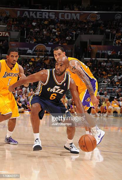 Jamaal Tinsley of the Utah Jazz drives under pressure during the game between the Utah Jazz and the Los Angeles Lakers at Staples Center on October...