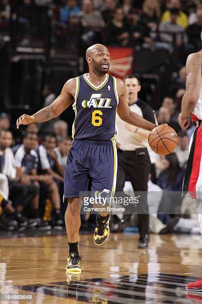Jamaal Tinsley of the Utah Jazz handles the ball upcourt against the Portland Trail Blazers on March 29 2013 at the Rose Garden Arena in Portland...