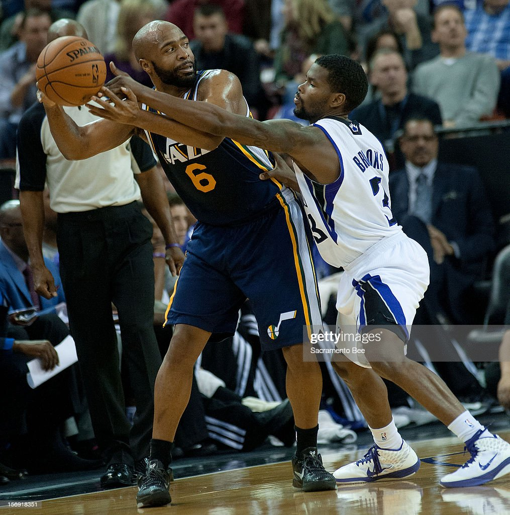 Jamaal Tinsley (6) of the Utah Jazz is defended by the Sacramento Kings' Aaron Brooks at Sleep Train Arena in Sacramento, California, on Saturday, November 24, 2012. The Kings topped the Jazz, 108-97.