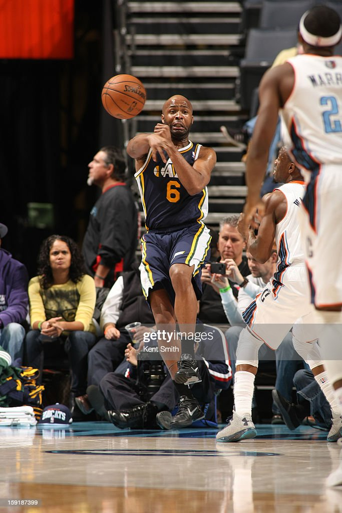 Jamaal Tinsley #6 of the Utah Jazz passes against the Charlotte Bobcats at the Time Warner Cable Arena on January 9, 2013 in Charlotte, North Carolina.