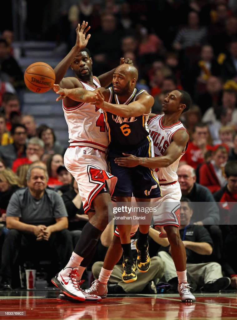 <a gi-track='captionPersonalityLinkClicked' href=/galleries/search?phrase=Jamaal+Tinsley&family=editorial&specificpeople=202203 ng-click='$event.stopPropagation()'>Jamaal Tinsley</a> #6 of the Utah Jazz passes between <a gi-track='captionPersonalityLinkClicked' href=/galleries/search?phrase=Nazr+Mohammed&family=editorial&specificpeople=201690 ng-click='$event.stopPropagation()'>Nazr Mohammed</a> #48 (L) and <a gi-track='captionPersonalityLinkClicked' href=/galleries/search?phrase=Marquis+Teague&family=editorial&specificpeople=7621183 ng-click='$event.stopPropagation()'>Marquis Teague</a> #25 of the Chicago Bulls at the United Center on March 8, 2013 in Chicago, Illinois.