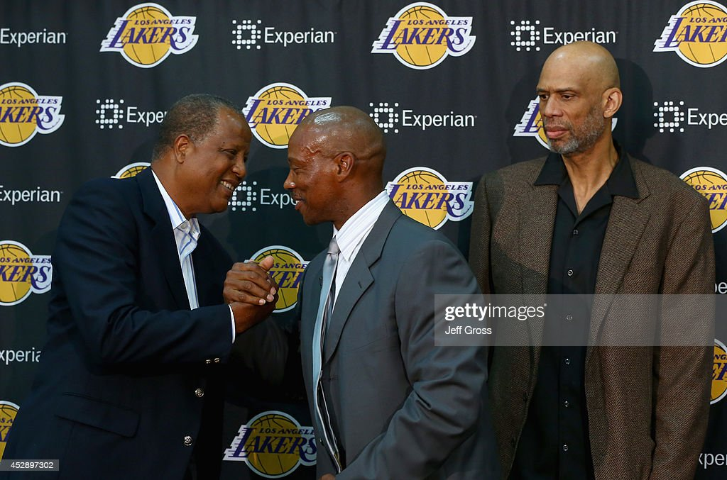 Jamaal Wilkes congratulates Byron Scott on becoming the new head coach of the Los Angeles Lakers, as Kareem Abdul-Jabbar looks on during a press conference at Toyota Sports Center on July 29, 2014 in El Segundo, California.